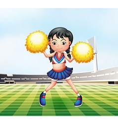 A cute cheerdancer at the soccer field vector image