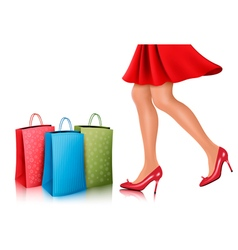 Shopping woman wearing red dress and high heel vector