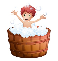 A young boy playing at the bathtub vector image vector image