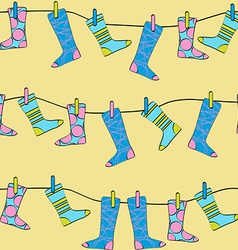 Seamless Pattern Socks Drying on the Clothesline vector image vector image
