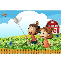 Kids catching butterflies at the field vector image vector image