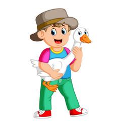 a farm boy holding a goose vector image