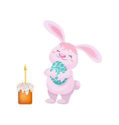 easter cake rabbit holding easter egg vector image