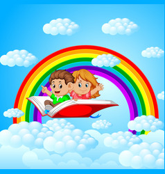 Happy kids flying on big open book with rainbow vector