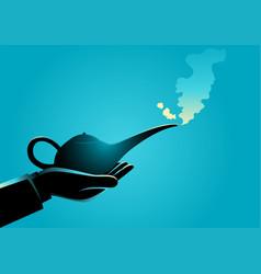 Man hand holding an arabian magic lamp vector