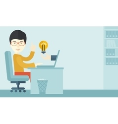 Asian guy working inside his office vector image