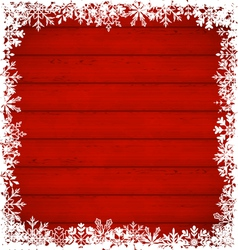 Christmas snowflakes border on wooden background vector