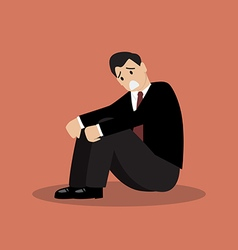 Desperate businessman sitting alone vector