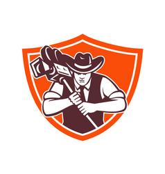 Cowboy camera operator shield vector
