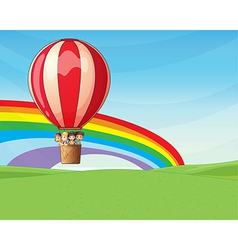 Children riding on a hot air balloon vector image vector image