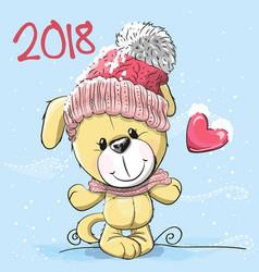 Cute cartoon puppy in a knitted cap vector
