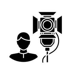 Lighting technician black glyph icon vector