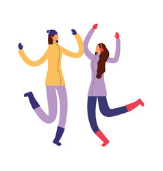 two women with winter clothes jumping vector image