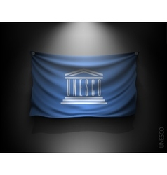 waving flag UNESCO on a dark wall vector image