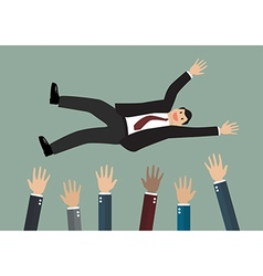People throw a businessman in the air vector