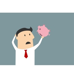 Businessman shaking empty piggy bank vector image