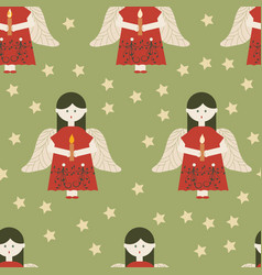 red angels on green background seamless pattern vector image
