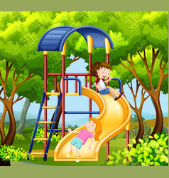 two girls on the slide in park vector image vector image