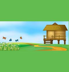 wooden hut in nature landscape vector image