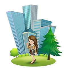 A woman near pine tree across tall vector