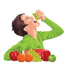 young boy eating fruit vector image