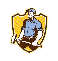Worker wielding sledgehammer crest retro vector