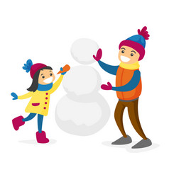 caucasian white boy and girl building a snowman vector image