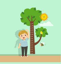 Cute cartoon boy measuring his height vector