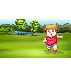 A boy jogging near the river vector image