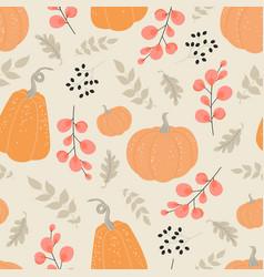 Autumn seamless pattern with pumpkins vector