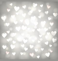 Shiny hearts bokeh vector
