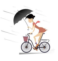 woman with umbrella rides a bike under the rain vector image
