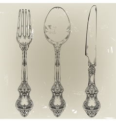 Hand drawn fork knife and spoon ornate vector
