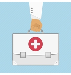 First aid kit in hands doctor vector image