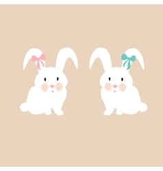 Cute bunnies with pink and blue bow vector