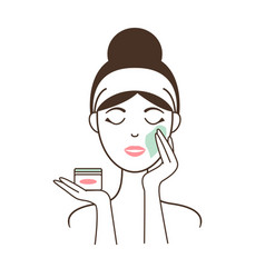 Woman applies soft delicate cream on her face vector