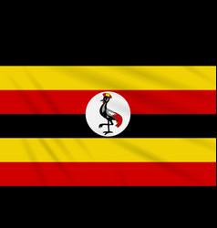 Flag uganda swaying in wind realistic vector