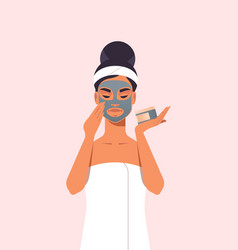 young woman applying black face mask dressed in vector image