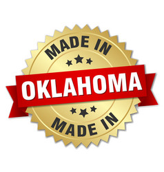 Made in oklahoma gold badge with red ribbon vector