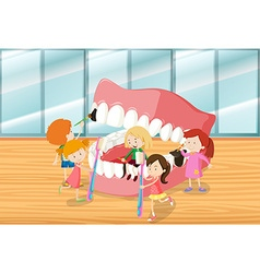 Children cleaning teeth together vector