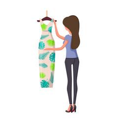 Woman choosing new summer vogue long modern dress vector
