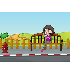 A woman sitting on a bench vector image