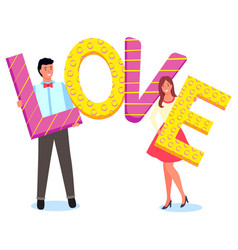 cute couple holding letters word love vector image