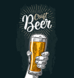Male hand holding a glass craft beer lettering vector