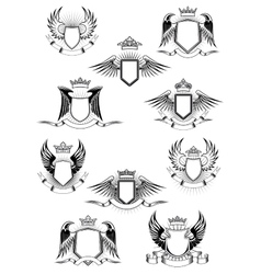 Heraldic winged shields with crowns and ribbon vector image