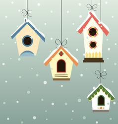 Abstract hanged bird house set in snowfall vector image vector image