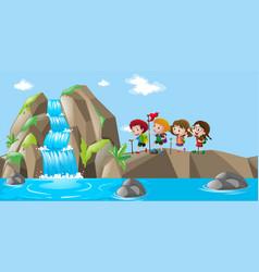 Waterfall scene with kids hiking up vector