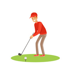 Golf player in a red pullover and cap taking a vector