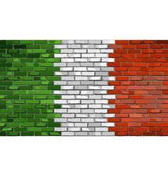 Grunge flag of Italy on a brick wall vector image