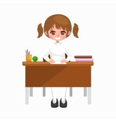 little girl sitting at the table with notebooks vector image